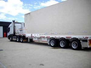 Semi flatbed truck ready for another job