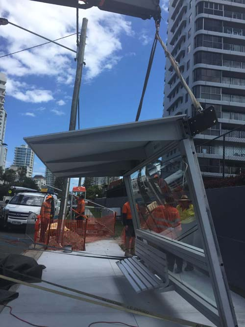 Crane Truck Installing Bus Shelter On The Gold Coast
