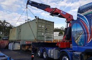 Semi crane truck transporting a 40 foot container in Arundel, Gold Coast