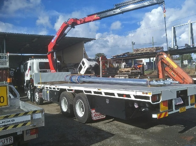MACHINERY TRANSPORT WITH CRANE TRUCK IN BRISBANE
