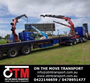3 Crane Truck Working Together