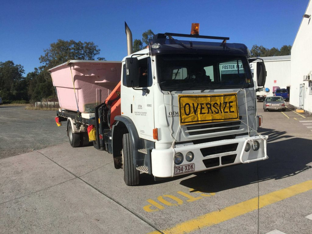 crane truck transporting pool