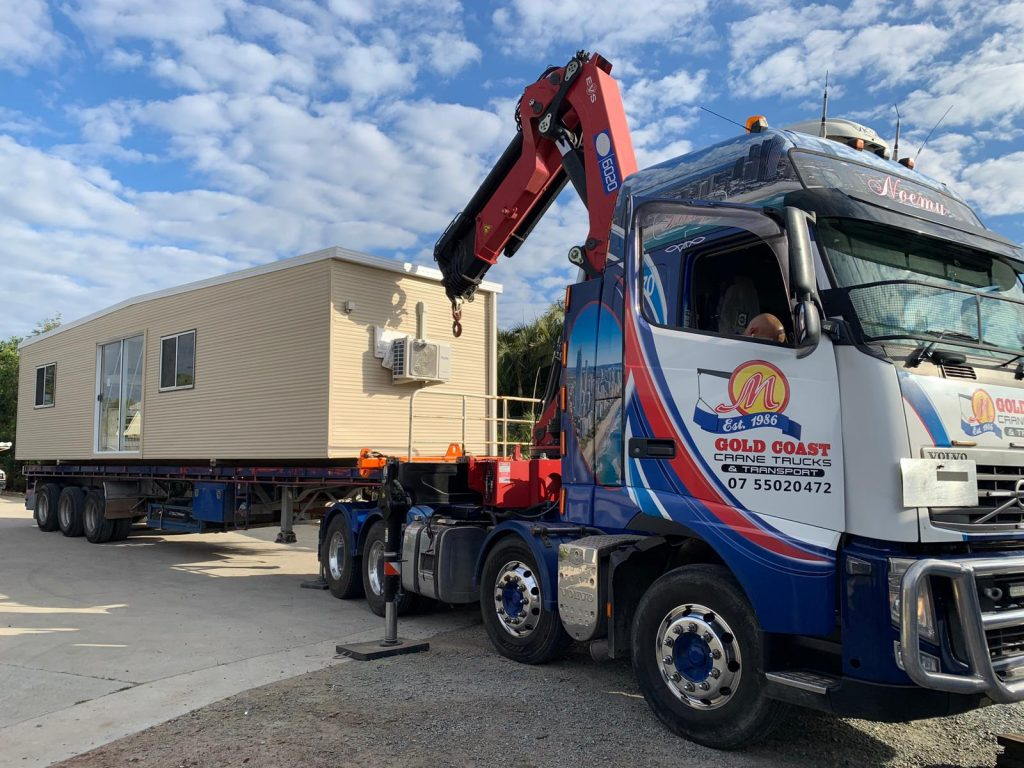 Our biggest semi crane truck transporting buildings from Upper Caboolture to Russell Island