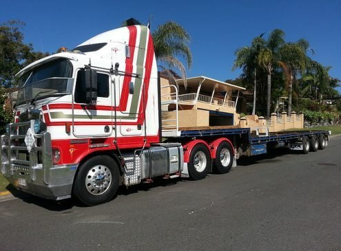 Semi truck with drop deck trailer ready to service a client in Nerang, Gold Coast