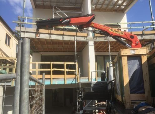 Crane truck glass delivery in Burleigh, Gold Coast. Craning to the first level.