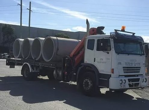 8 tonne crane truck delivering concrete pipes in Yatala, Gold Coast