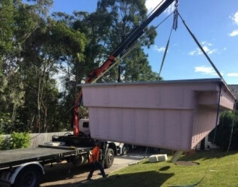 Crane truck pool transport and install in Daisy Hill, Brisbane