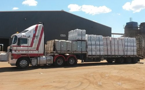 Semi truck for hire with 13 meter drop deck trailer