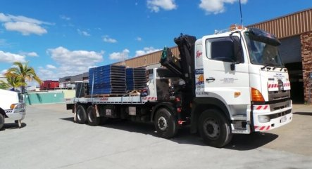 Our tilt tray / crane truck servicing our clients on the Gold Coast