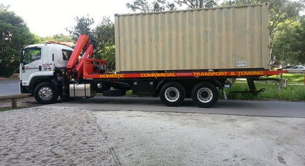 Tilt tray truck transporting containers from Brisbane to Gold Coast