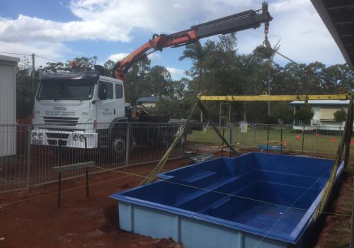 pool transport with crane truck