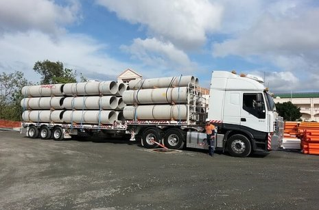 Concrete Pipe Delivery With Semi Trucks