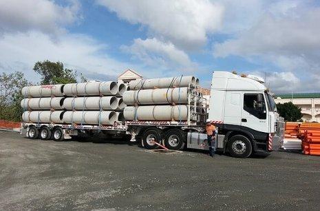 Concrete Pipe Delivery With Semi Trucks