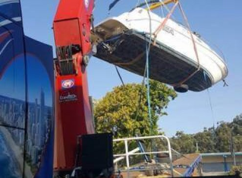 Craning a boat in Molendinar, Gold Coast with our semi crane truck