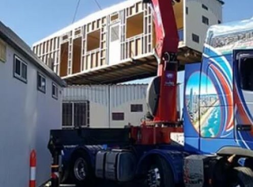 Portable building transport with our semi crane truck in Coomera, Gold Coast