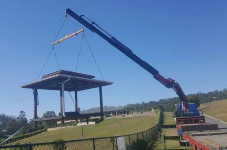 Semi crane truck installing park bench in Worongary, GoldCoast